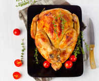 Whole roasted chicken on plate Royalty Free Stock Photo