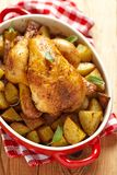 Whole Roasted Chicken with potatoes Stock Images