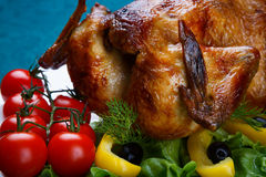 Whole roasted chicken served with fresh vegetables Stock Images