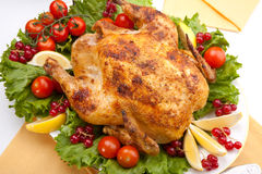 Whole roasted chicken on table Royalty Free Stock Photo