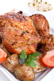 Whole roasted chicken with vegetables Royalty Free Stock Image