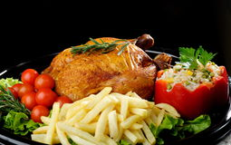 Whole roasted chicken with vegetables Royalty Free Stock Images