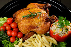 Whole roasted chicken with vegetables Royalty Free Stock Photography