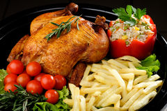 Whole roasted chicken with vegetables Stock Image