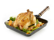 Whole roasted chicken with vegetables on the white backround Stock Photo