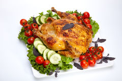 Whole roasted chicken on white Royalty Free Stock Images