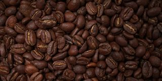 Whole roasted coffee beans Textured. Closeup of roasted coffe beans - background texture Stock Photos