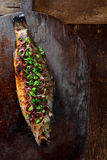 Whole Roasted Fish Garnished with Green Onions Royalty Free Stock Photography