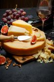 Whole round Head of parmesan or parmigiano hard cheese and wine. On concrete background or table Stock Photography