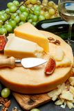 Whole round Head of parmesan or parmigiano hard cheese and wine. On concrete background or table Stock Photo