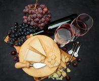 Whole round Head of parmesan or parmigiano hard cheese and wine. On concrete background or table Stock Image