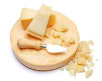 Whole round Head and pieces of parmesan or parmigiano hard cheese. On white background Stock Photography