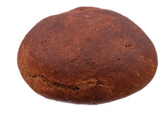 Whole round rye bread on white. Whole round rye bread isolated on white Royalty Free Stock Images