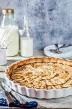 Toffee Apple Tart. Whole Round Toffee Apple Tart in a White Ceramic Pan, copy space for your text Royalty Free Stock Photography