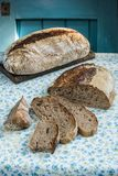 Whole rye and whole wheat sourdough bread. On a flowered table cloth royalty free stock images