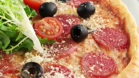 Whole salami pizza with cherry tomatoes stock video