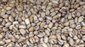 Whole salted pistachio nuts in nutshells close up Royalty Free Stock Image