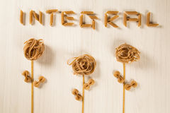 Whole-shaped integral pasta with flowers on a white wooden table.  stock images