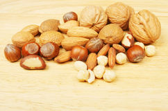 Whole and shelled nuts Stock Photos