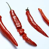 Sliced fresh red chillies isolated on white Stock Photography