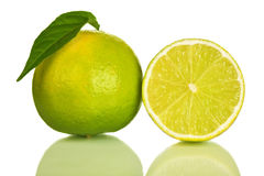 Whole and slice of lime isolated. On white background Royalty Free Stock Images