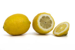 Whole and sliced ​​lemons stock photography