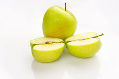 Whole and sliced apple with reflection Royalty Free Stock Images