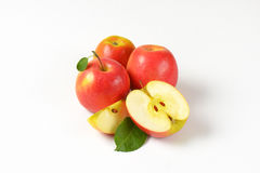 Whole and sliced apples Stock Photos