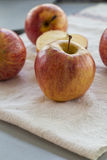 Whole and sliced apples with leaves Royalty Free Stock Photography
