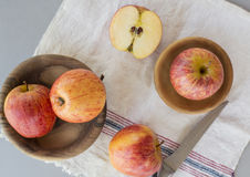 Whole and sliced apples with leaves Royalty Free Stock Images