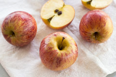 Whole and sliced apples with leaves Royalty Free Stock Photos