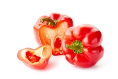 Whole and sliced bell peppers over white. Whole and sliced bell peppers isolated on white background Royalty Free Stock Images