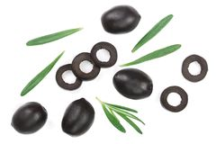 Whole and sliced black olives with rosemary leaves isolated on white background. Top view. Flat lay pattern Stock Photo