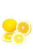 Whole and Sliced Bright Yellow Meyer Lemons. Whole and Sliced  Bright Yellow Meyer Lemons  Isolated on White Background Royalty Free Stock Photos