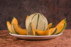 Whole and sliced cantaloupe  Royalty Free Stock Photos