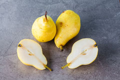 Whole and sliced Corella pears Royalty Free Stock Photos