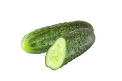 Whole and sliced cucumber isolated on white. Background royalty free stock photos