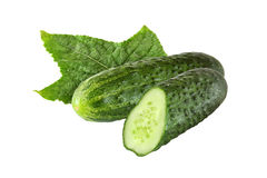 Whole and sliced cucumber with leaf isolated. On white background stock image