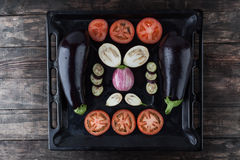 Whole and sliced eggplants and tomatoes. Royalty Free Stock Image