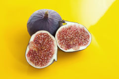 Whole and sliced figs, elevated view Royalty Free Stock Photo