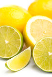 Whole and sliced fresh limes and lemons on on white, DOF Royalty Free Stock Photography