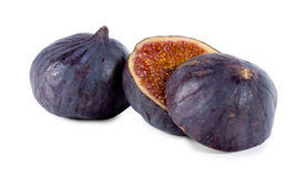 Whole and sliced fresh purple fig Royalty Free Stock Image