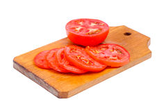 Whole and sliced fresh red tomatoes Royalty Free Stock Photo