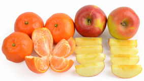Whole and sliced fruits Stock Photography