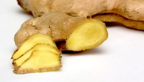 Whole and sliced ginger root Royalty Free Stock Image
