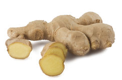Whole and sliced ginger root Royalty Free Stock Photo