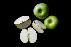 Whole and sliced green apples from above Stock Photos