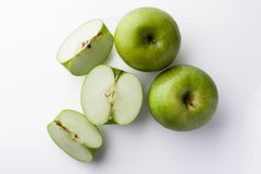 Whole and sliced green apples from above on white Stock Photo