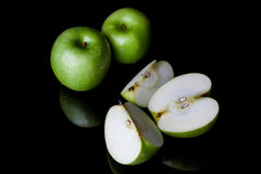 Whole and sliced green apples from side high angle Royalty Free Stock Images