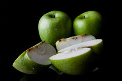 Whole and sliced green apples from side Stock Images